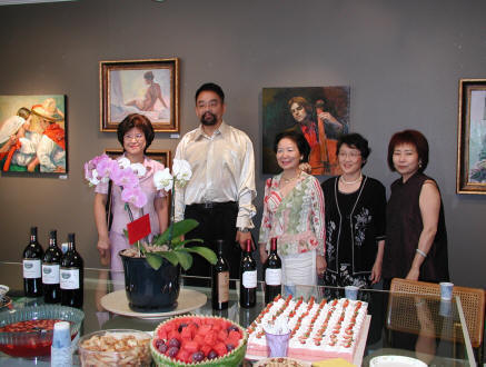 Artist William Wong (second left) and Ms. Gloria Chiu (first left) and his other students on the art show reception